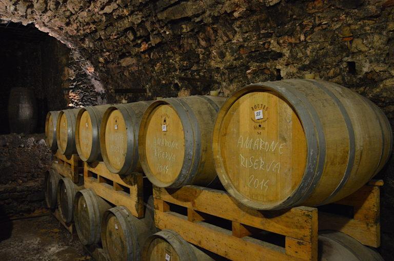 Several barrels of Amarone Riserva 1888 Villa Canestrari in the wine cellar