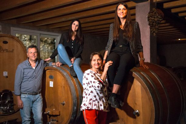 Veronica and Alice with their parents in the barrel room