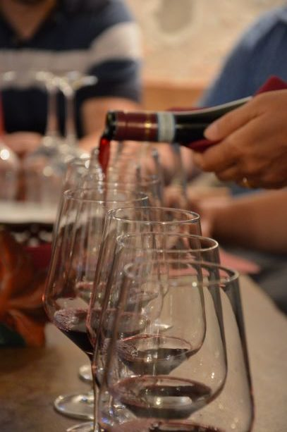 Pouring wine before a wine tasting at Corte Archi